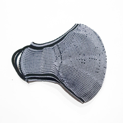 Premium Nylon knitted face mask in black/silver reverse side. Flatlay on the half