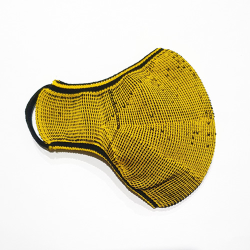 Premium Nylon knitted face mask in black/yellow reverse side. Flatlay on the half