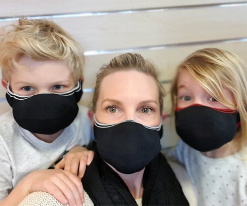 Female Adult and 2 young children wearing Interknit's Premium non medical fabric face mask